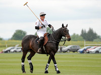 Silver Fox polo team patron Parke Bradley on horseback