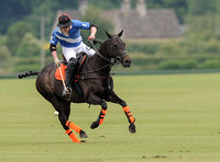 Ollie Severn polo action shot in Lodge Service colours.