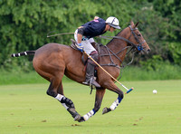 full horse left to right polo action shot of Lochie Hunter