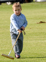 Young Harry Wood playing with polo mallet