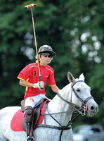 Alexander Horvat on horseback wearing sunglasses and polo helmet