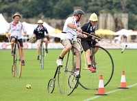 Penny Farthing Polo with the Cowdray Ruins behind