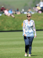 Lady walking across polo ground at treading in time