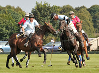 Chairmans Cup polo action between Coxwell and Noon Giraffe